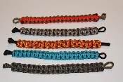 Survival Bracelets made of braided parachute cord